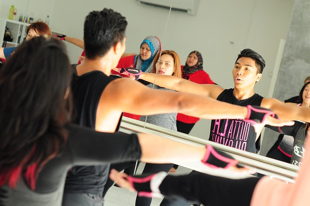 Group fitness class with people exercising